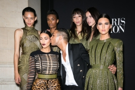 PARIS, FRANCE - JULY 09: French Stylist Olivier Rousteing poses with Kim Kardashian and her sister Kendall Jenner and Balmain Army models (L-R) Binx Walton, Ysaunny Brito, Issa Lish, Amanda Wellsh during the Vogue Foundation Gala as part of Paris Fashion Week at Palais Galliera on July 9, 2014 in Paris, France. (Photo by Richard Bord/WireImage)